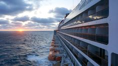 Queen Mary 2 at Sea During Sunrise ~ POPULAR CRUISING VIDEO PODCAST – What One Is To Do with Six Sea Days on the Queen Mary 2 | Popular Cruising (Image Copyright © Jason Leppert)