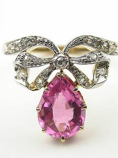 Pink tourmaline and diamond ring with bow motif, circa 1920 or later