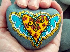 Painted Rock, Cape Cod Sea Stone. Giving My Heart Wings... A little bit country..a little bit Boho Winged Heart. Super smooth sea stone that tumbled a long time in the ocean. A free form shape stone with color in the hand painted design of golden, sunshine yellow,