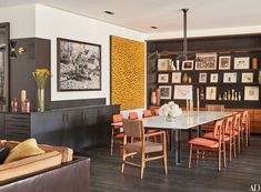 A large C-print by Vik Muniz (left) and a canvas by Yayoi Kusama overlook the dining room table.