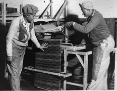 World War II allowed more opportunities for African-Americans to fill jobs on the B&O Railroad. Here cleaners use a scrubbing machine to clean seat cushions at the Mount Clare shops in 1943. Pictured are Gussie Davis (left) and Mary Franklin. Davis steadies the cushion while Mary lowers the lever to operate the brushes.