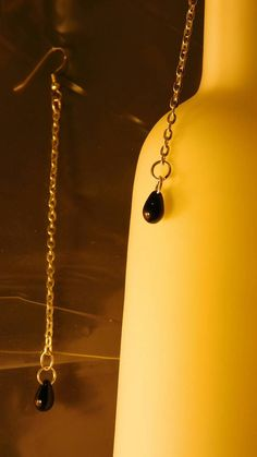 Check out this item in my Etsy shop https://www.etsy.com/listing/268958361/black-tear-drops-on-chains