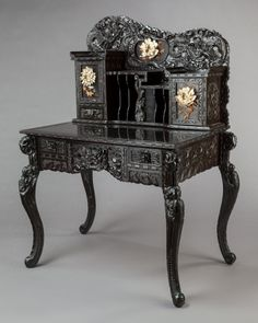 Asian:Japanese, A JAPANESE CARVED EBONIZED WOOD WRITING DESK . Maker unknown, Early20th century. 53-1/4 x 36 x 24-1/2 inches (135.3 x 91.4 ....