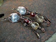 Dramatic chandelier earrings with fiery gemstone beads & etched copper metalwork.