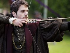 Estella admires Daniil in the courtyard as he demonstrates the art of archery to Mikhail.