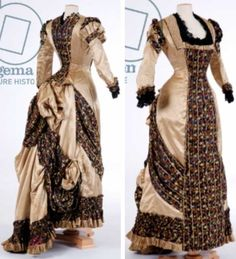 """Evening dress, 1870s (silk satin), English school. Example of the relatively short-lived fashion in the late 1870s for the """"princess"""" line dress, an all-in-one slender dress which fastened with a line of buttons or hooks. Would have been worn with a bustle. Bridgeman Archives"""