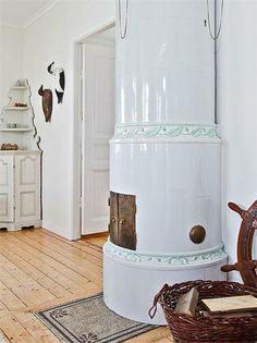 Scandinavian white fireplace.