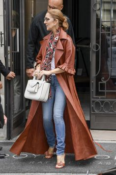 Oh, okay, Celine. I see you. Just bopping around the streets of Paris in an amazing brown leather trench coat from a brand the fashion world adores. Supes casual.