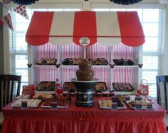 Clever idea to use a bookshelf/cubby divider as a background for this dessert table.  Adds vertical interest, and provides more places for treats!    Minnie Mouse Bake Shop Birthday Party.