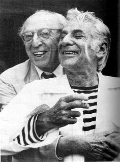 Good friends Aaron Copland and Leonard Bernstein share a hug.