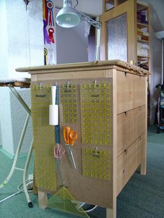 Pegboard on the cutting table. The Organized Cutting Table Sewing Room Design, Sewing Room Storage, Craft Room Design, Sewing Spaces, Sewing Room Organization, My Sewing Room, Craft Room Storage, Fabric Storage, Sewing Rooms
