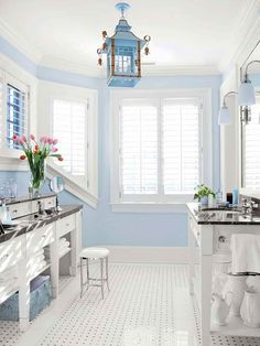 Baby blue walls step quietly in this classically decorated bathroom. Neither too bold nor too bright, the blue walls perfectly complement black marble countertops, white trim, and black-and-white floo Pastel Bathroom, Diy Bathroom Vanity, Bathroom Colors, Bathroom Ideas, Paint Bathroom, Bathroom Vintage, Classic Bathroom, Vintage Tile, Bathroom Cabinets