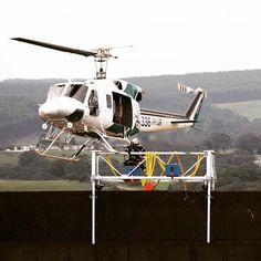 This is one of our very favourite shots - Andy stepping out of a moving #helicopter onto a #Trimcast #spacecase #jayrow #jayrowhelicopter #jumping #harnesses #safety #coolingtower #pelican #pelicancases