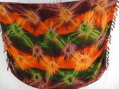 starburst orange green brown sarong pareo tie dye clothing - http://www.wholesalesarong.com/blog/starburst-orange-green-brown-sarong-pareo-tie-dye-clothing/