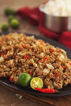 Sisig is a popular Filipino dish. It is composed of minced pork, chopped onion, and chicken liver. It is a favorite dish for pulutan. Pork Recipes, Asian Recipes, Vegetarian Recipes, Cooking Recipes, Healthy Recipes, Ethnic Recipes, Easy Filipino Recipes, Asian Foods, Salads