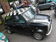 Black and white Mini Cooper...one of the vintage by Austin Martin, not the new ones. So cute!