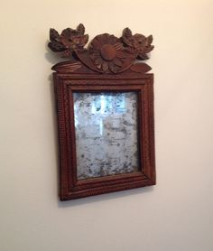 These were often carved by men for their sweethearts. I looked for one (I could afford) for some years. The crest is and the flower is all carved of one piece of wood. New England Style Homes, Antique Mirrors, Through The Looking Glass, Primitive Decor, Mirror Mirror, Pilgrim, Primitives, Antique Furniture, Home Accessories