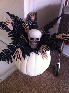Halloween skeleton pumpkin.  Got everything I needed at Michael's.  cut a hole in the top and heated up the glue gun, easy!