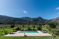 Have you ever seen something as stunning as this is? It's all about green and blue to get the perfect combo.  #pool #countryside #villaforsale #pollentiaproperties #mallorca