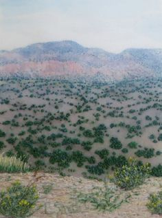 Desert Vista 2.75 x 3.75 inches. Free motion machine embroidery and hand sewing on hand-painted silk. A view of mountains north of Santa Fe, New Mexico. Louise Smith
