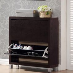 DETAILS Stash your shoes stylishly in this modern Shoe Cabinet, fits neatly against a wall in a hallway, mud room, or entryway. Product: Shoe Cabinet