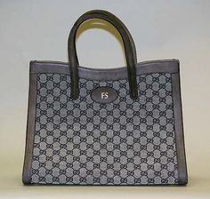 Since people were wearing such casual things, and a lot of the same things, as a way to distinguish their own wealth, they used accessories. This could include purses, shoes, etc. These would have the name brand all over them like this Gucci purse.