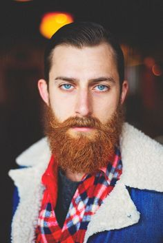<3 Smoking eyes. Amazing beard and moustache. Doing nothing but staring deadpan into the camera and making me wonder what perverse desires he might have in mind. Excellent use of moustache wax.