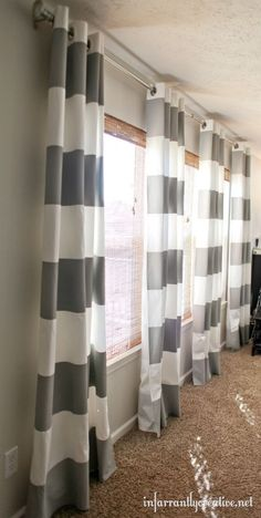 DIY painted, stenciled curtains - need something like this (maybe not this color/pattern) for the 3 large windows in the living room...
