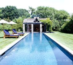 At the far end of the pool sits a new pool house constructed of wood and fieldstone. Backyard Pool Designs, Small Pools, Outdoor Living, Outdoor Decor, Cool Pools, Traditional House, The Hamptons, Beautiful Homes, Bali