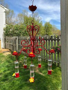 Old chandelier as a bird or hummingbird feeder.