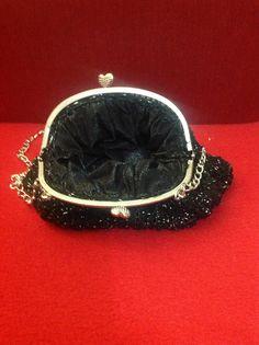 Pochette retró nera con filo argento