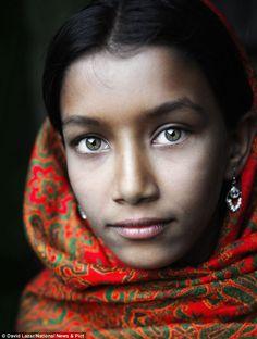A girl with green eyes wearing a headscarf in Putia, a Bangladeshi village