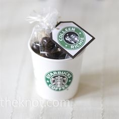 Wedding Gift Idea  The local Starbucks provided small coffee cups, which were then filled with chocolate covered espresso beans and mini biscotti. Colleen's maid of honor designed custom tags with a Starbucks-inspired logo.