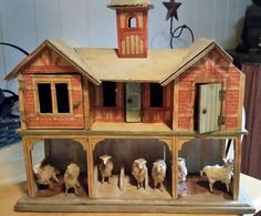 """German barn with sheep.  No date or maker given for barn.  The barn is about 18"""" tall and 18"""" wide and 6"""" deep."""