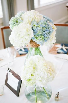 "Blue and White Beach Inspired Wedding (This website has a lovely, laid-back ""rustic"" beach wedding look - very close to what I'm looking for myself.)"
