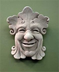 """Garden Sprite Plaque stone garden outdoor wall hanging Nature Carruth by Carruth. $49.99. Size: 5"""" by 6 1/4"""" by 2"""". Features the smiling botanical face of a garden sprite. Perfect decoration for a garden wall or patio!. Made in the USA. Made of hand cast stone. Add a whimsical feel to the outdoors with this charming Garden Sprite plaque by Carruth Studio. This hand cast stone plaque measures approximately 5 inches by 6 1/4 inches and features the joyful smiling face of a garden s..."""