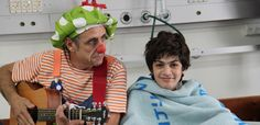 An Israeli medical clown visits with a young Israeli patient at the children's hospital. (Photo: Daniel Estrin)