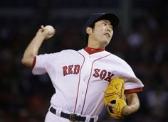 Boston Red Sox relief pitcher Koji Uehara throws against the Detroit Tigers in the ninth inning during Game 1 of the American League basebal...