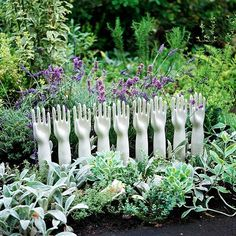 Fill gloves with concrete, peal off! Cute addition to any garden or flowerbed! Paint them different colors to add extra pop to your Landscaping