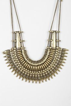 Ornate metal-bead bib accent in tarnished gold. #urbanoutfitters