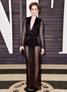 Lily Collins wearing a black beaded lattice tuxedo wrap gown at the 2015 Vanity Fair Oscar After-Party
