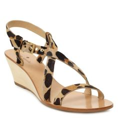 Dip your toe into mixing patterns by pairing these with a printed maxi dress in an abstract floral