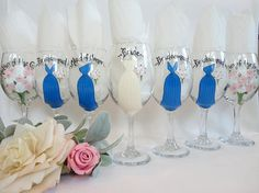 WHAT A CUTE KEEPSAKE FOR THE BRIDAL PARTY TO REMEMBER YOUR SPECIAL DAY!! These unique hand painted bridal party wine glasses will be PAINTED TO YOUR EXACT DRESSES that you will be wearing in YOUR wedding! They make the perfect thank you gift to everyone that took part in your wedding, or give them to the bridal party as an invite to be in your wedding! ---------------------------------------------------------------------------------------- GLASSES INCLUDE…