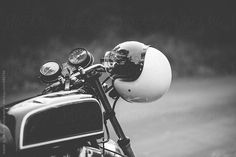 White helmet hanging onto motorcycle.   Isaiah & Taylor Photography for Stocksy United