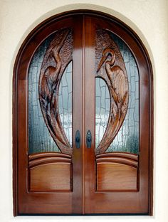 Egret Roundtops by Fine Woodworks Custom Doors. This solid mahogany set of doors reflects the estuary that the property sits on. Made of Hand-Carved Honduran Mahogany. Visit our website for additional photos and pricing. Front Door Design Wood, Main Entrance Door Design, Wooden Door Design, Wooden Doors, Door Entryway, Entry Doors, Door Design Images, Exterior Doors, Modern Wooden House