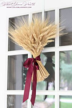 Welcome fall with a DIY wheat sheaf centerpiece or wreath courtesy of Julie Blanner
