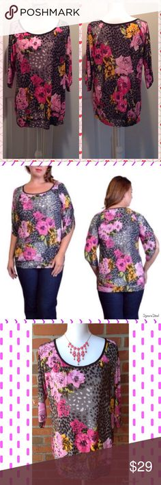 LAST ONE! Purple & Pink Floral Cheetah Print Top Size: 2X. Runs small. 92% Rayon and 8% Spandex. Tops