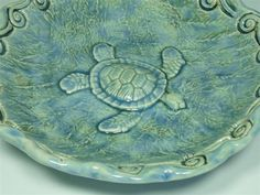 A sea turtle swimming in the ocean adorns the inside of this hand-built ceramic bowl. Description from etsy.com. I searched for this on bing.com/images