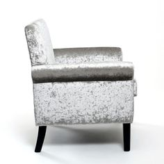 http://www.bonsoni.com/heima-crushed-velvet-silver-armchair-by-sherman   The Heima Armchair will add a touch of class to any room. The crushed velvet has a sensual and rich feel instantly creating an opulent and dramatic look. Available in Grape or Silver. This chair features dark rubber wood legs. Leg assembly required. Sold individually.  http://www.bonsoni.com/heima-crushed-velvet-silver-armchair-by-sherman