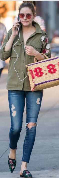 Who made Olivia Palermo's black floral mules, ripped skinny jeans, green flower jacket, and pink sunglasses?